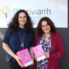 Picture of Anita and Natalie, with a copy of 'Kim Loves LIfe'