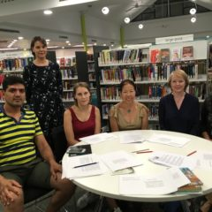 Rosalie (standing) and the Reading Circle participants in the library